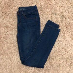 gently worn dark washed denim jeans